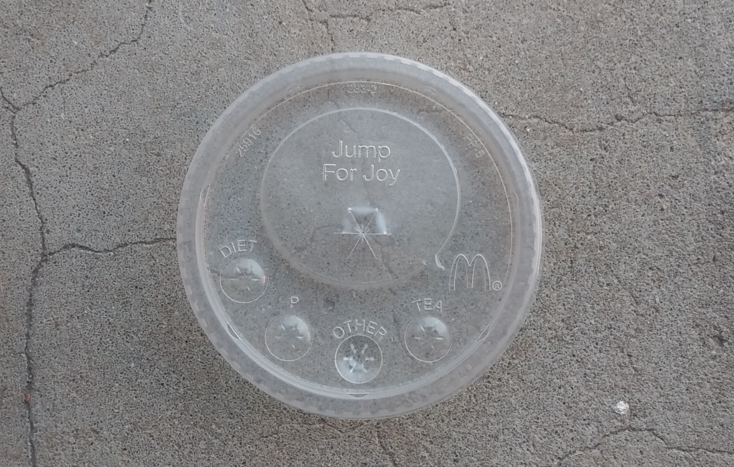 round buttons on your soda cup lid